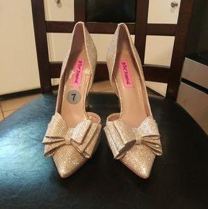 Betsy John's heels